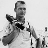 Dale Monaghen with Nikon F and 400mm German lens adapted to Nikon mount. Sports car race in Texas, 1960.