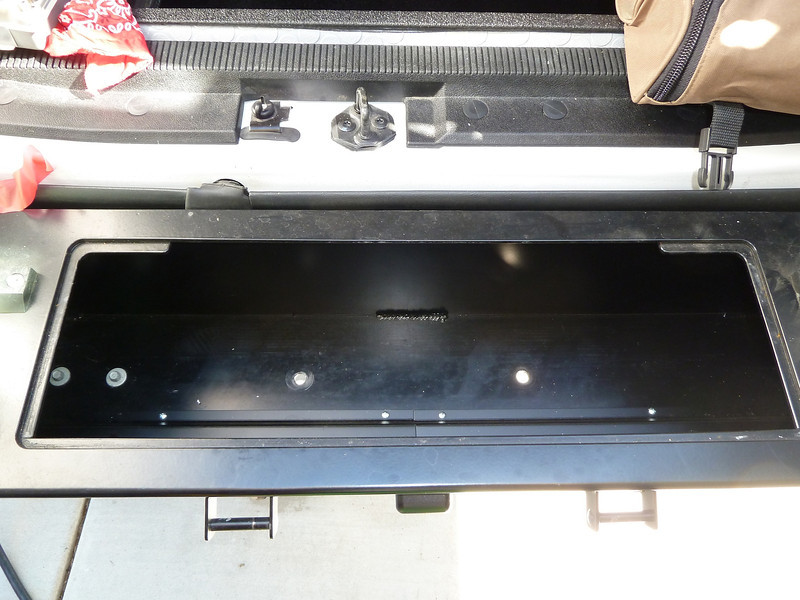 Rear bumper storage. A locking lid fits over the opening.