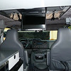 Monitor can be used by the back seat passengers when the van is on the road. Headphones are ready for use.