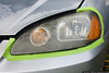 Driver Side - Before<br /> The green tape comes in the kit and is used to protect the finish around the headlight.