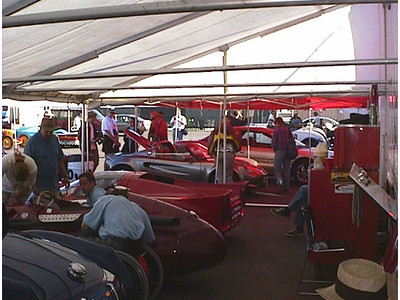 Monterey Historics sharing Burt's tent with some other cars.