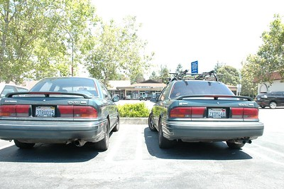 Butts of two butt-ass ugly cars -- awww yeah