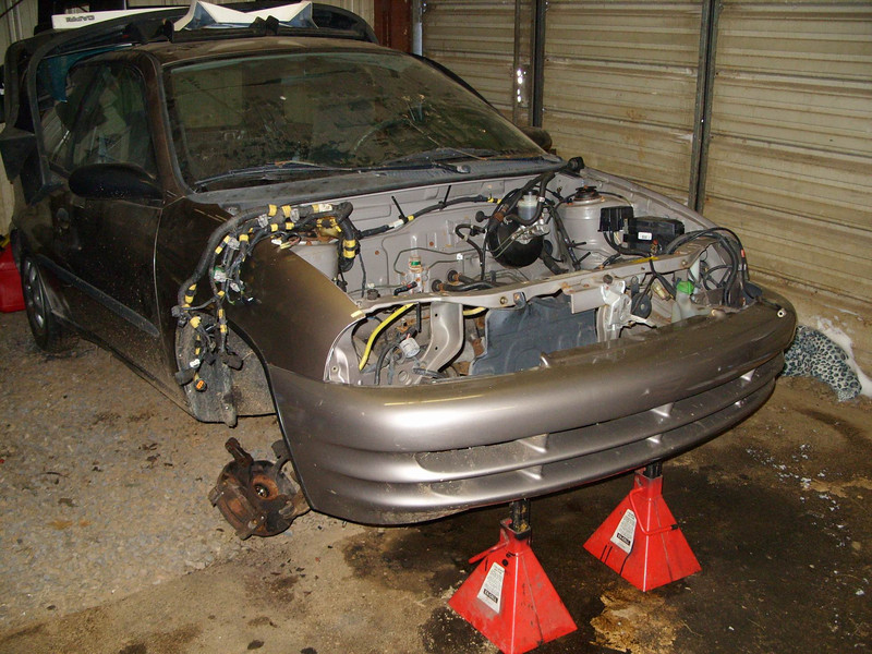 This is the donor car I bought.... the engine, trans, interior and most of the body panels are in excellent condition, but the underside unibody frame is rusted beyond repair... the front suspension actually collapsed while I was test driving it!