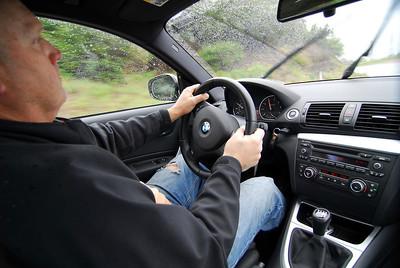 TC Kline at the wheel of his 128i.
