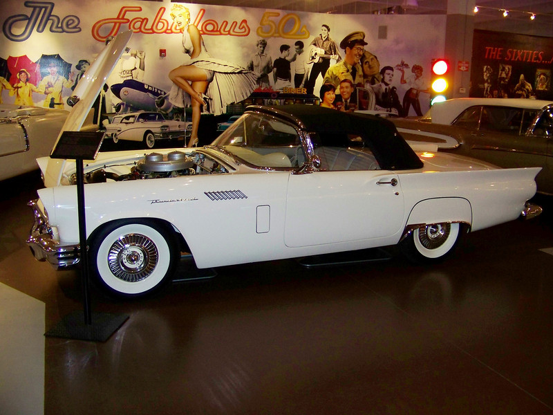 "1957 Ford Thunderbird E-type <br /> ""Two-4 barrel carburator""<br /> Production: 21,380<br /> Factory Price: $3,408.00<br /> Engine: 312 cubic inch-285 horsepower<br /> <br /> The Thunderbird was never sold as a full-blown sports car. Ford described it as a personal luxury car, a description which named a new market segment. This car is equipped with power steering, power brakes, memory seats, engine chrome dress up kit, tachometer, telescopic steering wheel and town & country radio. Eddie Dauer gave this car to Joanne Dauer as a gift in honor of their 25th wedding anniversary."