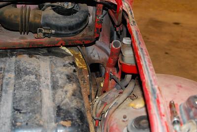 Dirt, rat waste, broken hinge, extra hole.  All not fun.