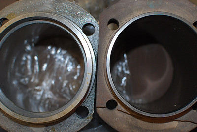 The differences in cylinder wall thickness.  Left is 92mm thick wall.  Right is 87mm slip-in.