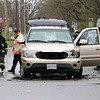 There was a three vehicle MVA at the corner of Franklin and Oak Hill Streets in Fitchburg on Thursday morning. Firefighters look over a Buick Rainier that was involved in the accident. SENTINEL & ENTERPRISE/JOHN LOVE