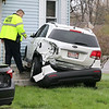 There was a three vehicle MVA at the corner of Franklin and Oak Hill Streets in Fitchburg on Thursday morning. This white KIA ended up on the lawn of Matt Lay who happened to be home and saw it heading to his house.SENTINEL & ENTERPRISE/JOHN LOVE