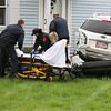 There was a three vehicle MVA at the corner of Franklin and Oak Hill Streets in Fitchburg on Thursday morning. First responders work on the injured driver of a white KIA that ended up on the lawn of Matt Lay's house on Oak Hill Street. SENTINEL & ENTERPRISE/JOHN LOVE