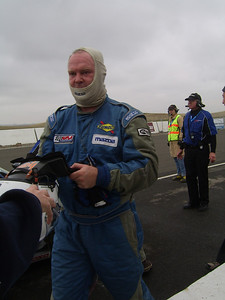 DRIVER CHANGE -- Car owner Dion Johnson of Santa Cruz leaves the hot pit following his first stint behind the wheel. He ended up notching the fastest lap of the race for A+Racing's No. 60 Miata.