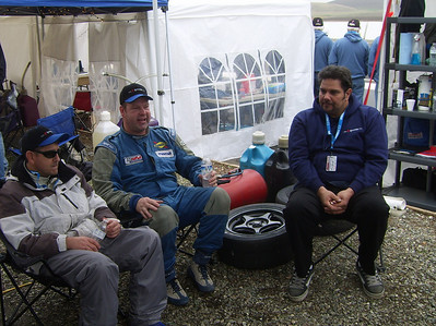 AT THE READY -- Drivers, from left, Jim Bucha of Citrus Heights, Dion Johnson of Santa Cruz and Al Angulo of Chicago Park relax in the team pit area.