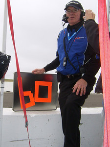 ON THE GRID -- A+Racing Team Manager John Sullivan of Fair Oaks holds the pit board as car 60 is signaled in for the first of its 13 pit stops.