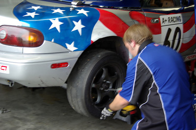 KEEP IT ROLLING -- Spencer Doty removes a wheel.