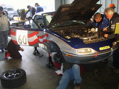 HECTIC REPAIR -- Team mechanic Mark Means of Meadow Vista, right, oversees the action as crewmembers make a hurried clutch repair.