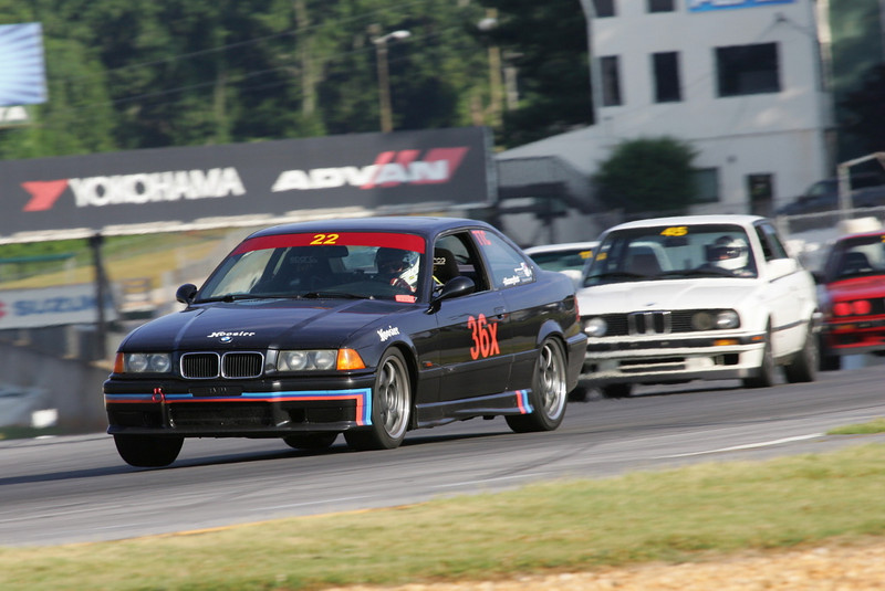 Road Atlanta, Peachtree-BMW CCA, July 2009: Hard pursuit by Adam Nitti in his E30 'Special' through Turn 1.<br /> <br /> HK/cts