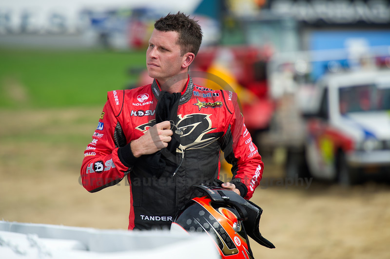 Garth Tander composed but not happy as he walks back to the pits after the crash.