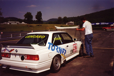 1997 - Lime Rock. Will Turner fine-tuning the hood shock on Chris Gengaro's E30 M3 Touring Car