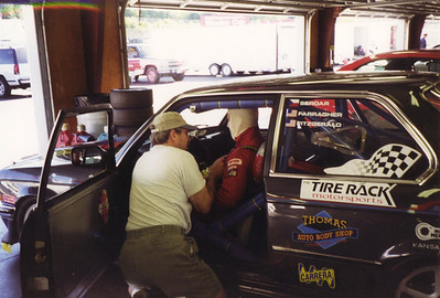 1997 - NHIS. John Farragher is strapped into the #09 PMS 323 by Steve Fitzgerald.