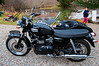 """This beauty pulled into our driveway during our final tag sale -- a 2009 Triumph Bonneville T100 (for its top speed) further enhanced by a Ural side car, checkered paint striping and attitudinal front fender plate.<br /> <br /> Emma rode in the side hack. You can see a better shot of her at <a href=""""http://tinyurl.com/lkymy2y"""">http://tinyurl.com/lkymy2y</a>."""