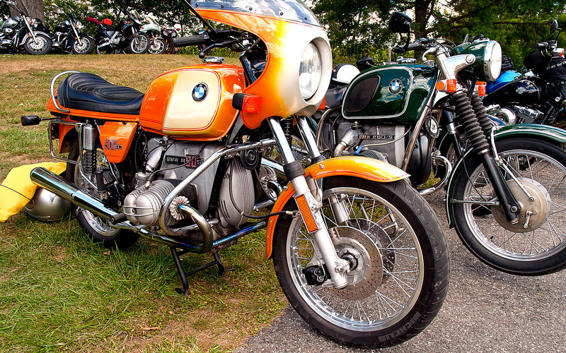 About 17,500 manufactured between 1974 and 1976, the R90S originally came in truly sweet TT Silver Smoke gray with (I think) a smaller bikini fairing and I wanted one badly, but would not give up the V7. This Daytona Orange scheme was not to my taste.<br /> <br /> The R60/5 was reputed to run on anything from kero to perfume and would have been best for the planned round-the-world ride we never quite got around to.