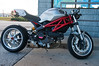 """2009 Ducati Monster 696 (Il Mostro in Italian) was initially a styling exercise attempting to build -- as Ducatti Technical Director Massimo Bordi put it -- """"the kind of bike Marlon Brando would be riding if The Wild One were being filmed"""" in the 90s. As it evolved, the bike became a highly versatile -- as many as nine different models were available some years -- and adaptable (Made to be modified, there were a wealth of after-market bolt-on options.) cruiser that accounted for over two thirds of Ducati sales.<br /> <br /> 12,000 Monster 696s were sold in 2009, the first Ducati model to break into five figure unit sales."""
