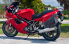 The Ducati ST2 was made between 1997 and 2003. <br /> <br /> The frame is a tubular trellis similar to the 916 in torsional rigidity and lightness. The ST2 engine is derived from the 907 Ducati Paso, but with an increased bore to 944cc and a heavier flywheel appropriate for touring.