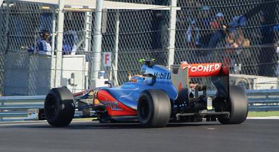 Lewis Hamilton, McLaren, exiting turn one.