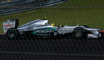 In this Mercedes is Schumacher's teammate, Nico Rosberg.