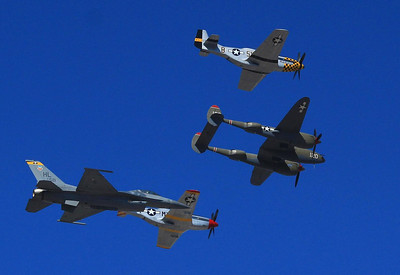Sunday's Heritage of Flight opened ceremonies with two P-51 Mustangs, a P-38 Lightning, and an F-16.