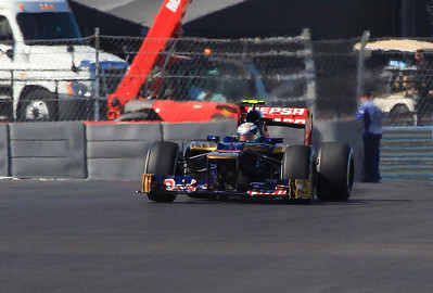 Frenchman Jean Eric Vergne in one of the Toro Rosso cars drifts out of turn 6. He set the course trap speed race record Sunday at 199 MPH.