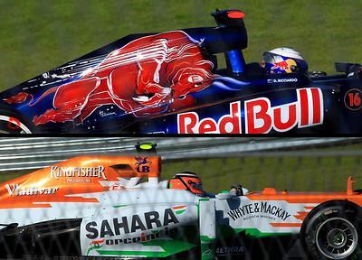 Colorful graphics on the Toro Rosso car of Australian Daniel Ricciardo, above, and Force India's Nico Hulkenberg.