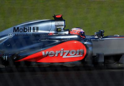 Jensen Button drives this chrome silver McLaren.