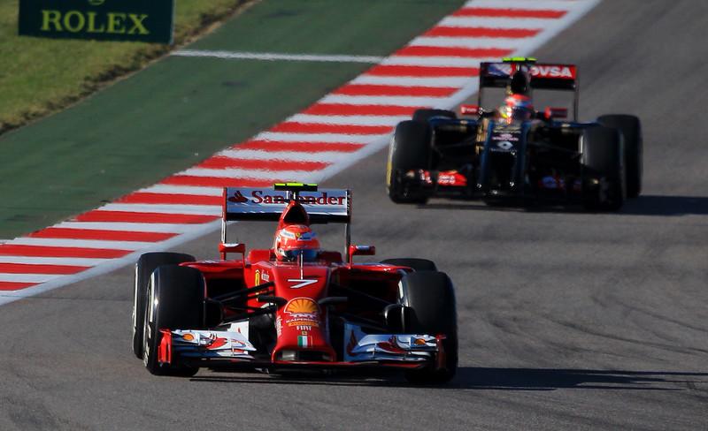 Kimi Raikkonen in his Ferrari leads newcomer Danil Kvyat (Toro Rosso Team) into turn 11.