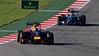 Last year's winner Sebastian Vettel is chased into turn 11 by this year's winner Lewis Hamilton.