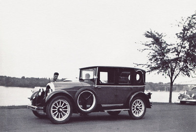 The 1919 Kissel Brougham had a black top, royal blue body with cream stripe and wheel spokes. I believe this car also had a straight eight. Photo taken in LaCrosse, Wisconsin. I think that's my cousin Philip looking over the hood.