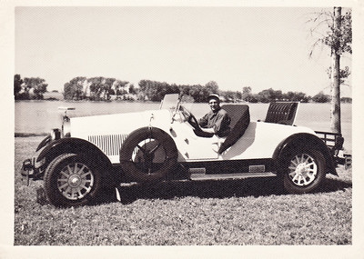 Here is my uncle Virgil Johnson sitting in his pride and joy, his 1925 Kissel Gold Bug. This car has a straight eight with a three speed manual transmission with straight cut gears. The Gold Bug was a favorite of movie stars and celebrities in it's day. Amelia Earhart was one famous owner. The Kissel Motor Company was located in Hartford, Wisconsin. Note the size of the wooden steering wheel.