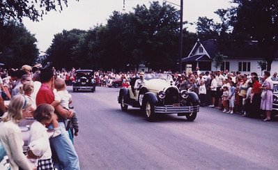 Virgil drives the Gold Bug in the annual Annandale, Minnesota parade on July 4, 1961.