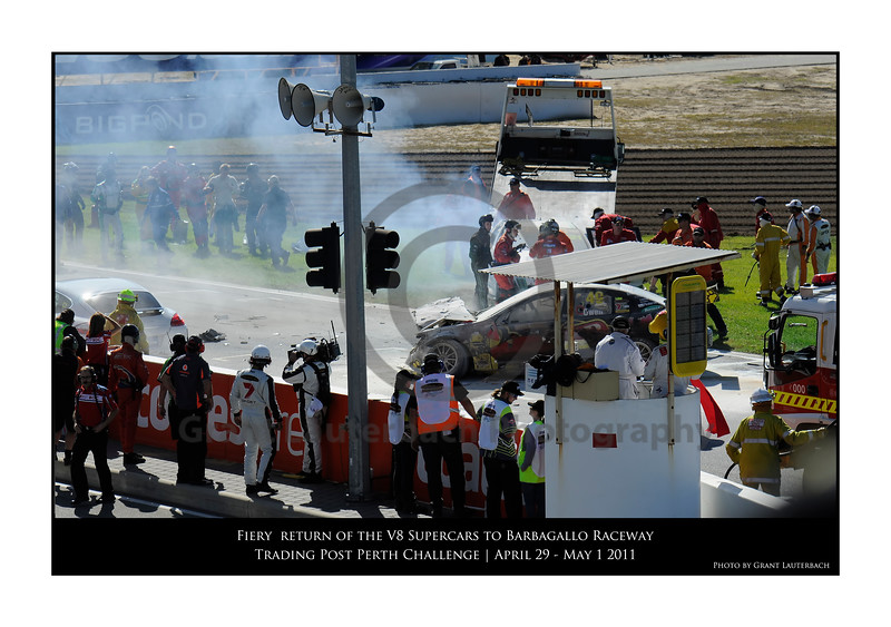 Karl Reindler being helped as the Ambulance is about to pick him up. A few burns but still walked away from what was the most explosive and destructive start line crash in V8 Supercar history. We can only hope it stays that way<br /> Time on my camera 10:37.05.86
