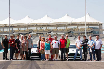 A group shot of all the lucky fans who won Hot Laps with the V8 drivers.