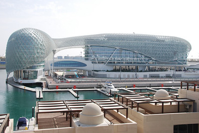 Yas Marina Hotel, the track passes under the walkway on the left side of the picture.  Our room was on the top floor with a view of the track from the balcony (and the music from the rooftop disco pounding until nearly 3am).  Ask for a room on one of the lower floors.