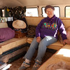 Ida shows off the living area of the bus. The camper area was designed by Don Reese and has three configurations. The floor can be raised as a table or the table can form the basis for a queen-sized bed.