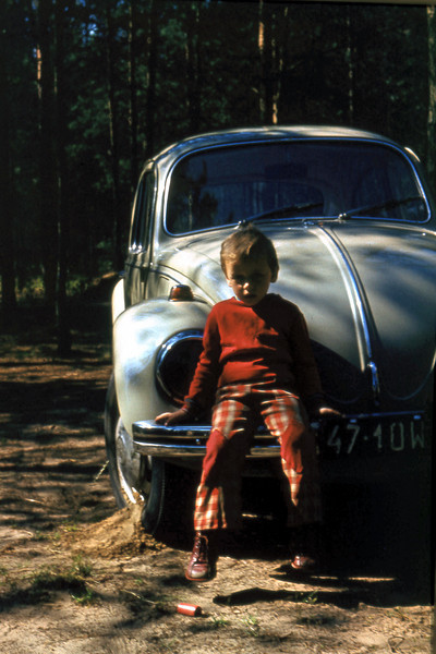 At our summer house in Urle, east of Warsaw with our 1970 VW Bug 1200. My father drove that car forever.
