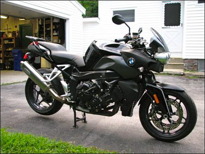 2004 BMW K1200R.  Seen in this photo after being painted black with white pinstripes - classic BMW.  This thing was a rocket.