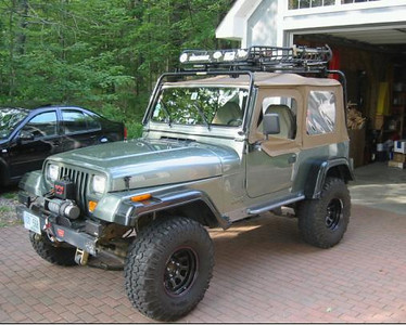 Jeep Wranger Sahara.  I forget what model year.  This photo is after it had been to the body shop.