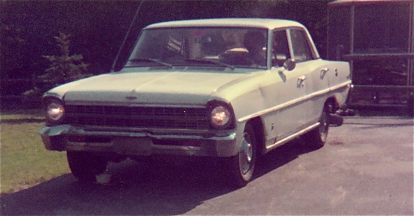 1967 Chevrolet Nova (Chevy 2).  My very first car in high school.  Purchased for $25.  That is me inside the car.  I think the car had a little brake fluid leaking at the right front.