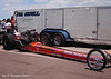 Top Fuel car of Jim Nicoll, 1971 NHRA Springnationals at Dallas. Nicoll's frame-severing clutch explosion at Indy against Don Prudhomme is the stuff of legend.
