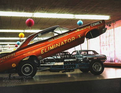 Nicholson Funny car at Dallas Merc dealer, 1966. This controversial car revolutionized funny car racing with the first tube chassis. Performance wise, no one with a stock frame-based funny car could touch it.