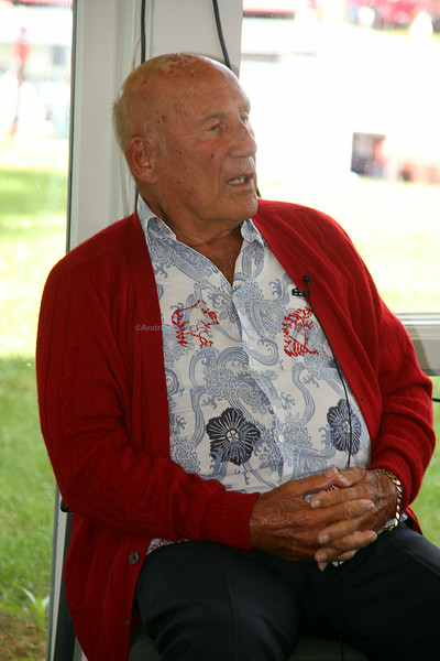 Sir Stirling Moss answers questions for the media at LRP