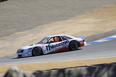 A 1986 Ford-Rousch Mustang driven by Phil Gallant negotiates the Corkscrew.